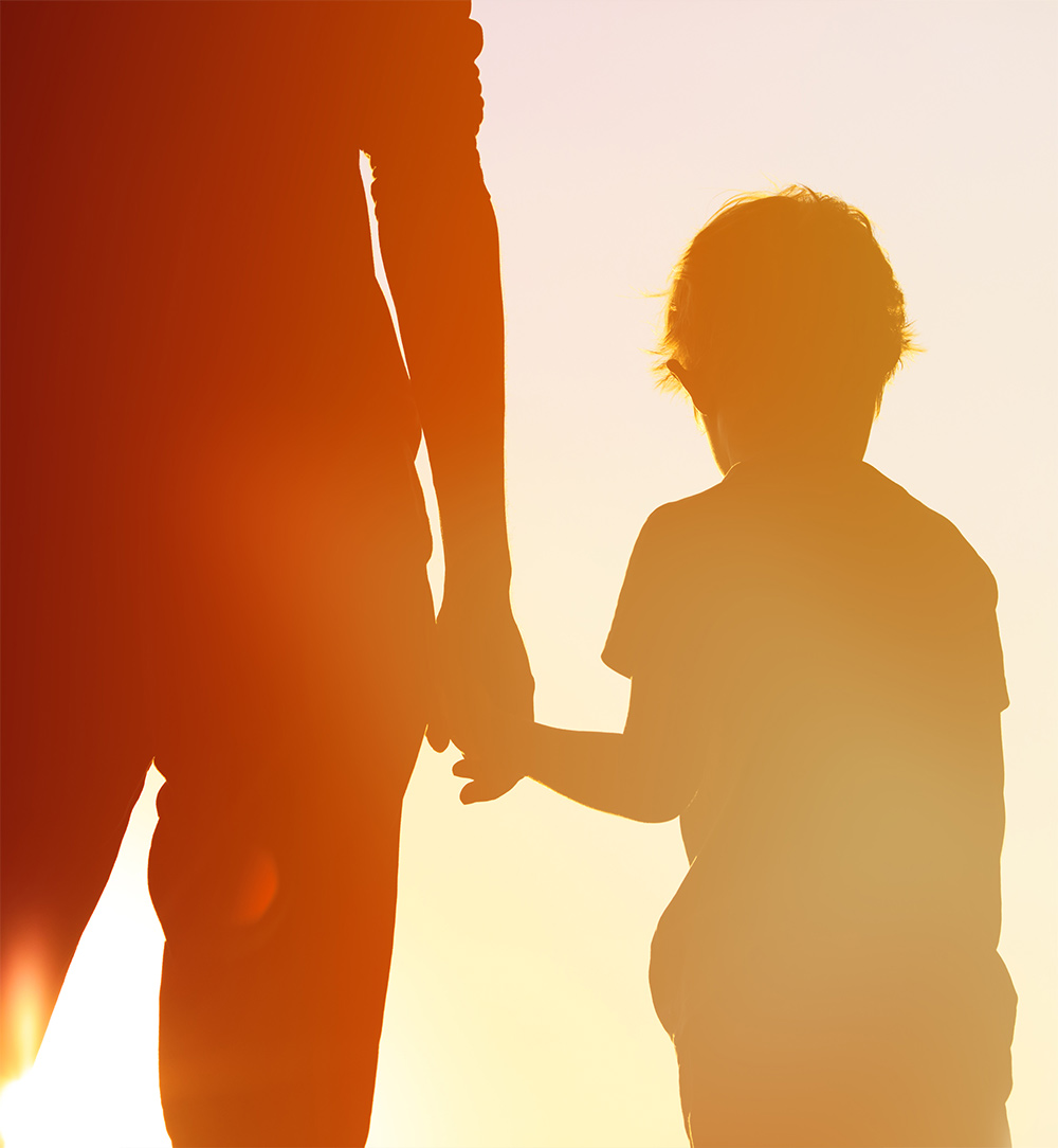 Man and a child holding hands